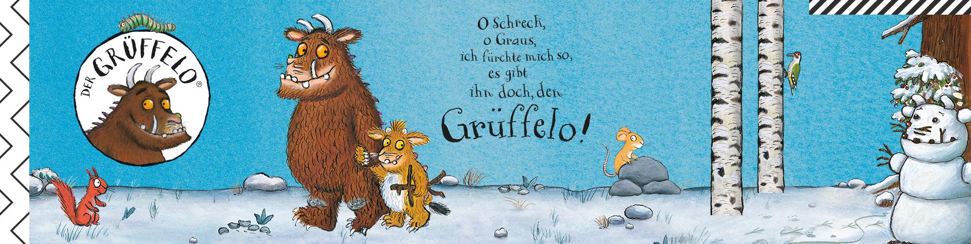 Eine winterliche Szene mit dem Grüffelo, dem Grüffelo-Kind und weiteren Tieren